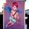 «Сердце не прячь, амур не промажет». Новое граффити на улице Фадеева